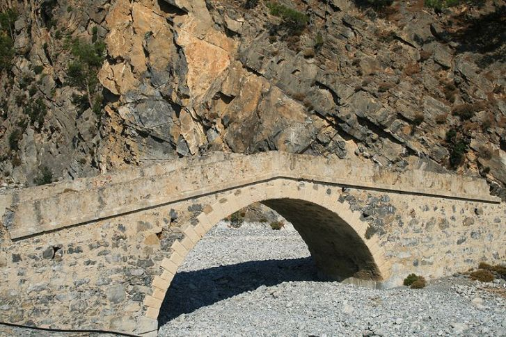 Stone bridge across a dry river bed in Agia Roumeli, Crete, Greece.  Image: Wikimedia