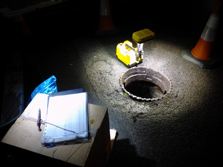 Adam sampling sewer water in Sheffield at 3am in search of lost urban streams